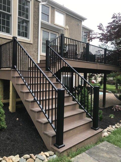 steps with composite decking and wrought iron railing