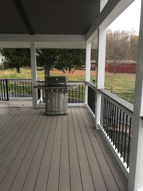 Grill on a composite deck built by Hawkins Carpentry