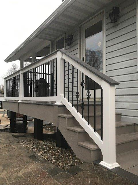 Outdoor steps and railing with pavers on the ground