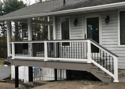 Composite decking on second story and railing on lower story